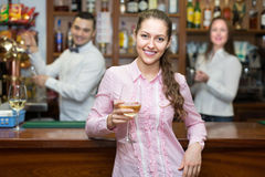 Girl flirting with barman at counter Royalty Free Stock Photo