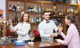 Girl flirting with barman at counter Stock Images