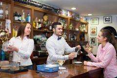Girl flirting with barman at counter royalty free stock photo