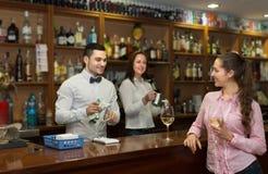 Girl flirting with barman at counter Stock Photo