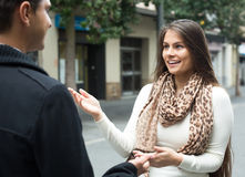 Girl flirting with guy at the street Royalty Free Stock Photo