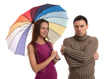 Girl flirts with her serious boyfriend Royalty Free Stock Photo
