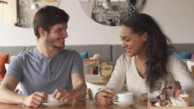 Girl flirts with her male friend at the cafe stock footage