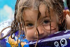 Girl on float. A portrait of a cute girl on a float, in swimming pool Stock Images