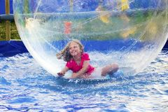 Girl in Floating Ball Stock Photo
