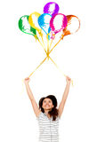Girl floating with balloons Stock Images