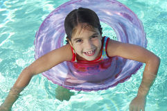 Girl Floating On Inflatable Raft In swimming Pool Royalty Free Stock Photo