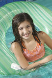 Girl Floating In Inflatable Ring Royalty Free Stock Photography