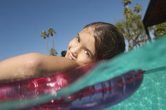 Girl Floating On Inflatable Ring In Pool Royalty Free Stock Image