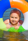 Girl floating in the river Stock Image