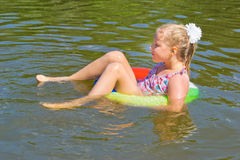 Girl floating in the river Stock Photo