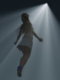 Girl floating towards the light Stock Image