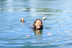 Girl floating on water Royalty Free Stock Photo