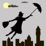 Girl floats under the moon with an umbrella in his hand Stock Photos