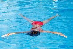 Girl floats on water Royalty Free Stock Photos
