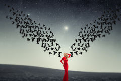 Girl and a flock of crows. Royalty Free Stock Images
