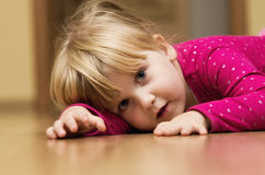 Girl on floor Royalty Free Stock Photos