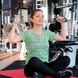 Girl on the floor with dumbbells stock photo