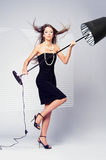 Girl and a floor lamp Stock Image