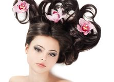 girl with floral arrangement on her hair Royalty Free Stock Image