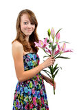 Girl with floral dress holding lily Stock Image