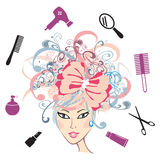 Girl with floral hair and hairdressing accessories Stock Photo