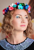 Girl with floral wreath Royalty Free Stock Image