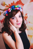 Girl with floral wreath Stock Images