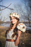 Girl, floral wreath and spring forest Stock Images