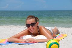 Girl on Florida beach. Teen enjoys summer vacation on Naples beach in Florida Royalty Free Stock Image
