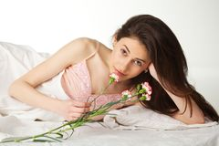 Girl with flover in the bed Stock Photography