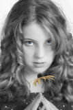 Girl with flower. Portrait of girl with flower, in sepia with touch of color in eyes and flower Stock Photography