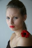 Girl with flower. Young beautiful sad girl with a red gerbera Stock Images