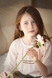 Girl with a flower Stock Images