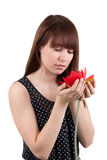 The girl with a flower. The beautiful girl with a red flower Stock Photo