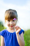 Girl with flower. Little girl with flower. outdoor shot. focus on a flower Royalty Free Stock Image