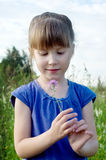 Girl with flower. Little girl with flower. outdoor shot. focus on girl's face Royalty Free Stock Photography