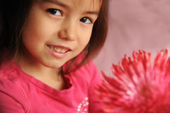 A girl with a flower Stock Images
