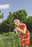 A girl and flower Stock Image