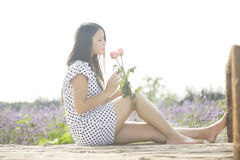 A girl and flower Royalty Free Stock Images