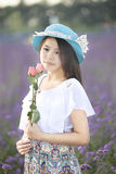 A girl and flower. An asian girl is in meditation with flower in hands in garden Stock Photography