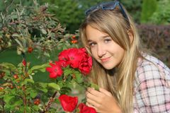 Girl with flower. The happy girl with red flower Stock Photo