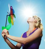 Girl with a flower against blue sky Stock Image