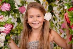 Girl in a flower arbor Stock Photo