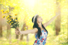 Girl with flower in autumn forest Stock Image