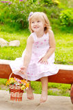 Girl with flower basket Royalty Free Stock Photography