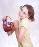 Girl with flower  basket Royalty Free Stock Images