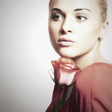Girl and flower. beautiful woman in red dress.Your text here Royalty Free Stock Images