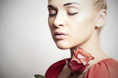 Girl and flower. beautiful woman in red dress.Your text here Stock Photography
