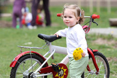 Girl with flower and bicycle Stock Photography